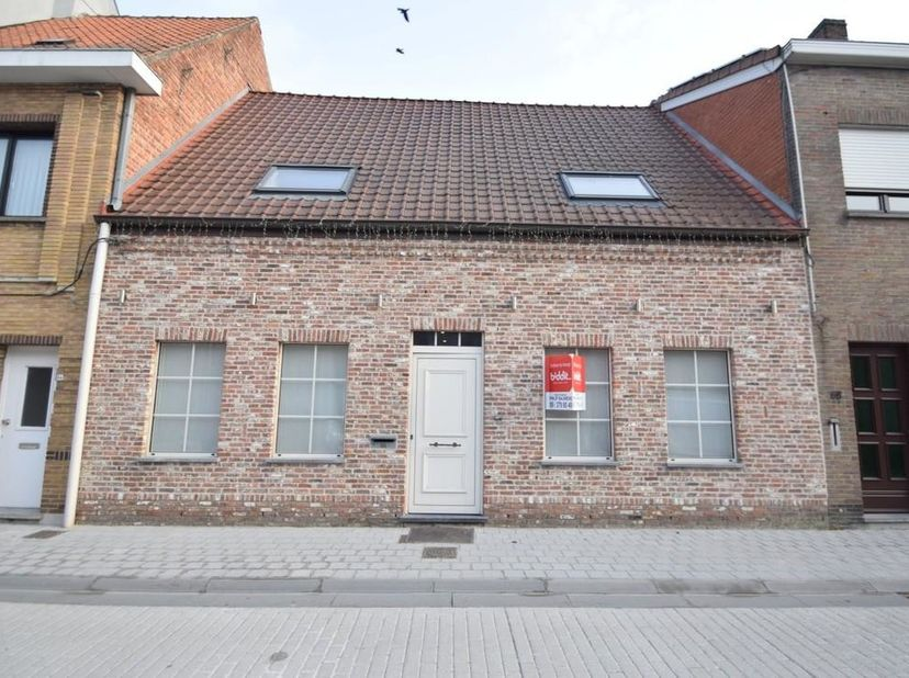 BIDDIT<br /> KNUSSE WONING ME TUIN IN CENTRUM<br /> Zeer goed gelegen gezellige woning met tuin te Sint-Laureins, Dorpsstraat 66, vlakbij school, wink