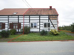 Te renoveren halfopen bebouwing met landelijke uitstraling gelegen in een groene omgeving op een perceel van 24a55ca, bouwjaar geschat 1900-1918, op h