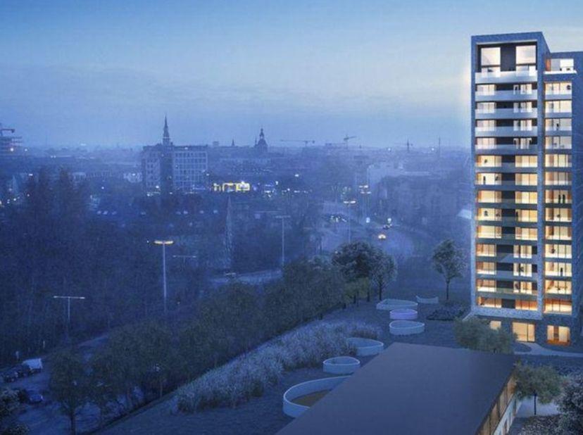 KAPERTOREN <br /> Appartement met één slaapkamer met open ingerichte keuken en groot terras (>12m²), gelegen op de 11e verdieping. Badkamer met douche