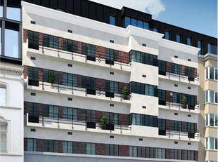 BIDDIT<br /> PRACHTIG GERENOVEERD APPARTEMENT<br /> In een building residentie PAUL STEVENS, op en met grond, gelegen, Kortrijksepoortstraat 122-126-1