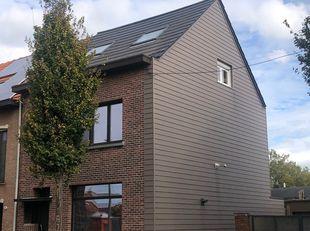 IN OPTIE !! Instapklare woning met garage en mooie tuin in het centrum van Reet.<br /> Deze woning met kelder, garage en oprit is gelegen in een rusti