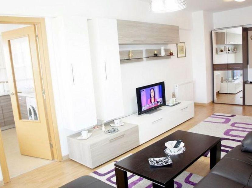 Dit appartement op het 2de verdiep is uitgerust met een inkomhal, twee slaapkamers, berging, badkamer. De materialen zijn van hoogwaardige kwaliteit.